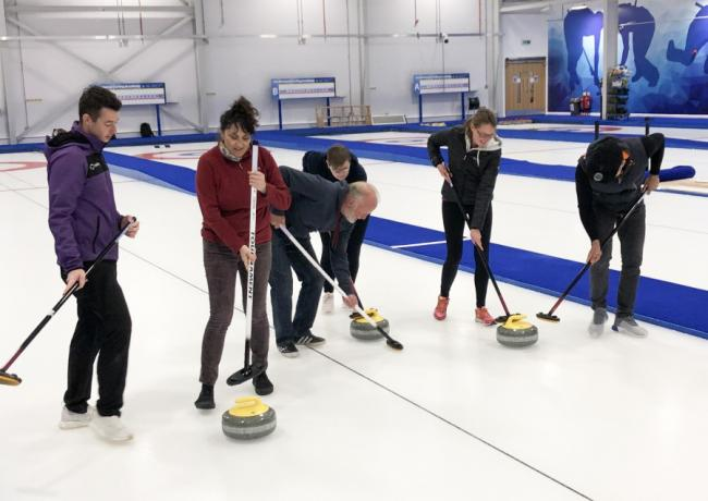 Veterans enjoy trying curling in Stirling with coach Hammy McMillan (left)
