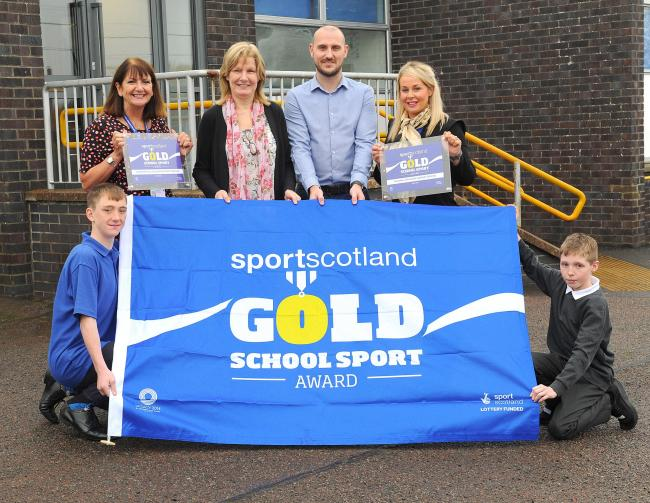 Chartershall School pupils Gregor Sutherland and Mikey Hughes, with headteacher, Yvonne Wright (left of centre); deputy headteacher Charlene Mitchell (right of centre); Cllr Susan McGill and Steven Coulter, partnership manager sportscotland
