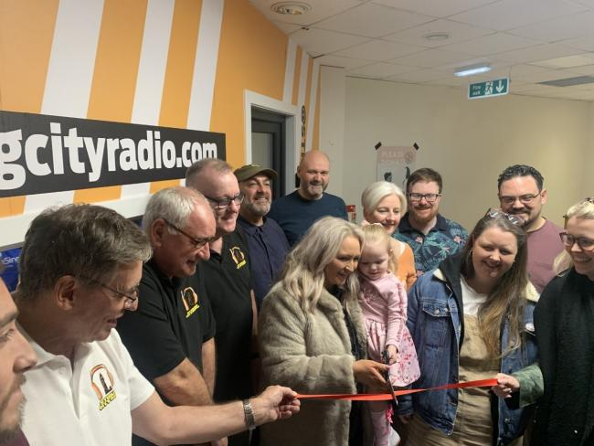 Carmen cuts the ribbon with mum Lynsey to open the new studio