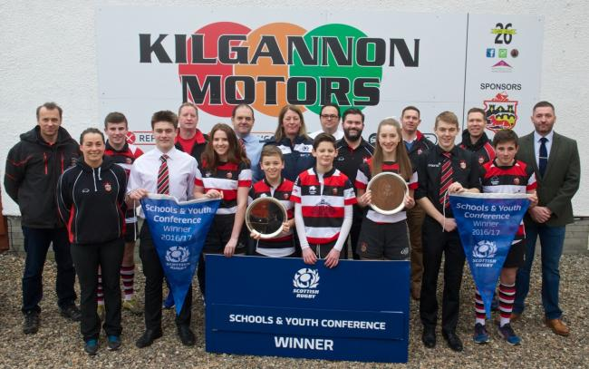 Dee Bradbury, vice-president of the Scottish Rugby Union, and Steven Clydesdale of Kilgannon Motors are photographed with players and coaches representing all the successful teams who are part of Stirling County's Rugby Academy