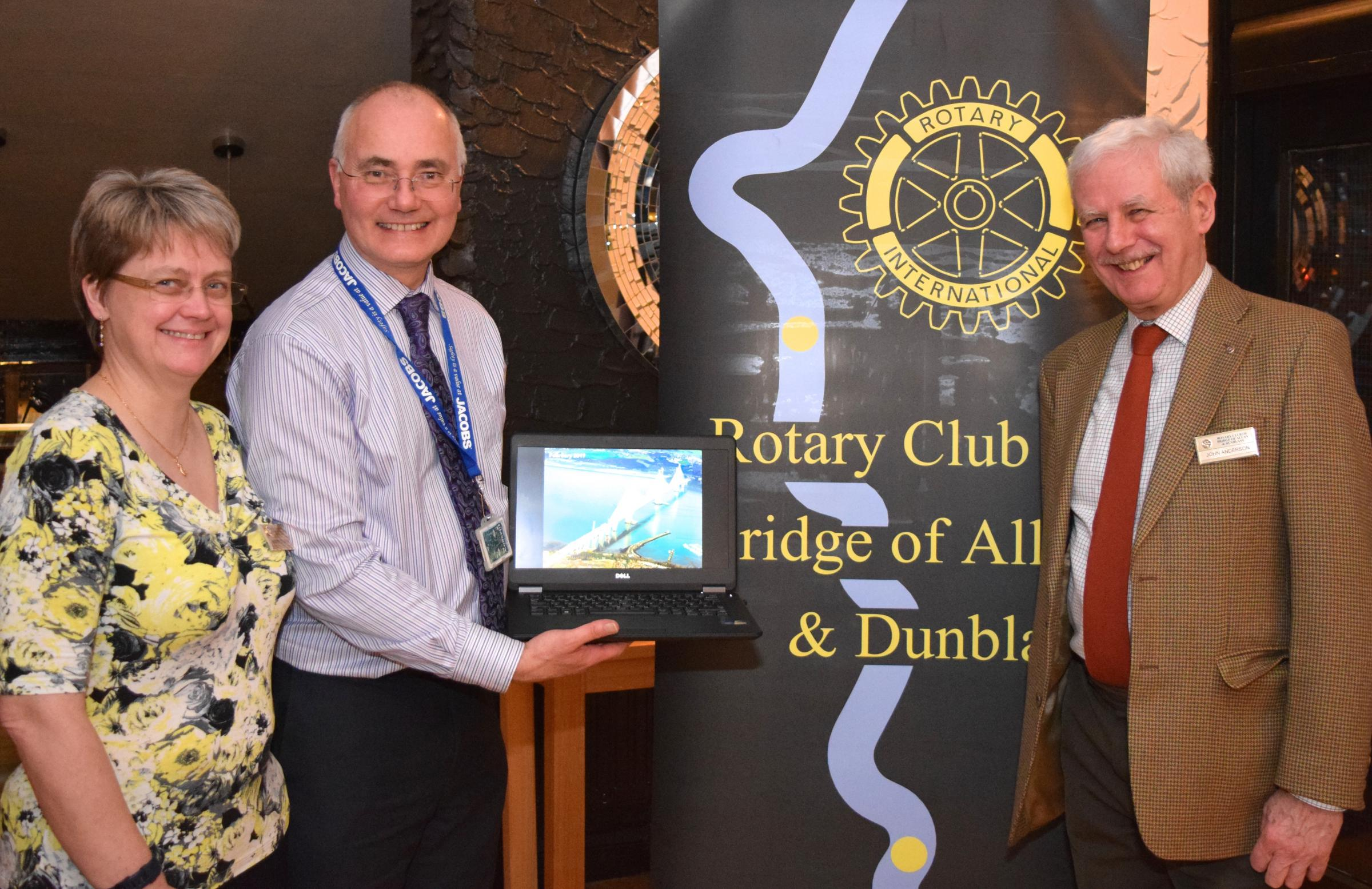 Alastair Templeton (centre) gives a preview of his talk on the Queensferry Crossing to John Anderson, speaker's host, and Audrey Cooper