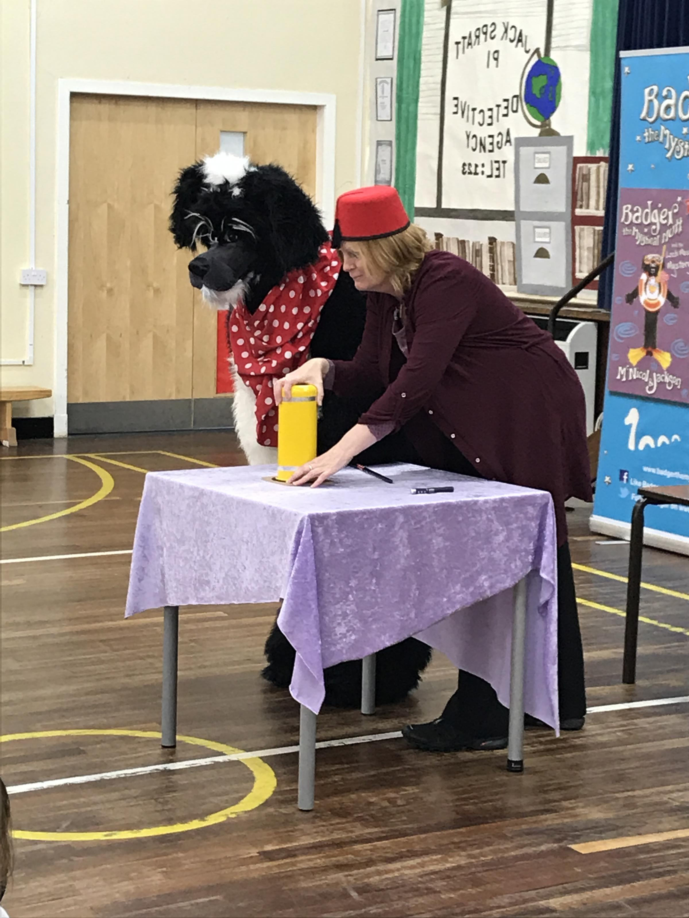 Badger the Mystical Mutt authors Lyn McNicol (dressed as Badger ) and Laura Jackson entertaining pupils from P1-3
