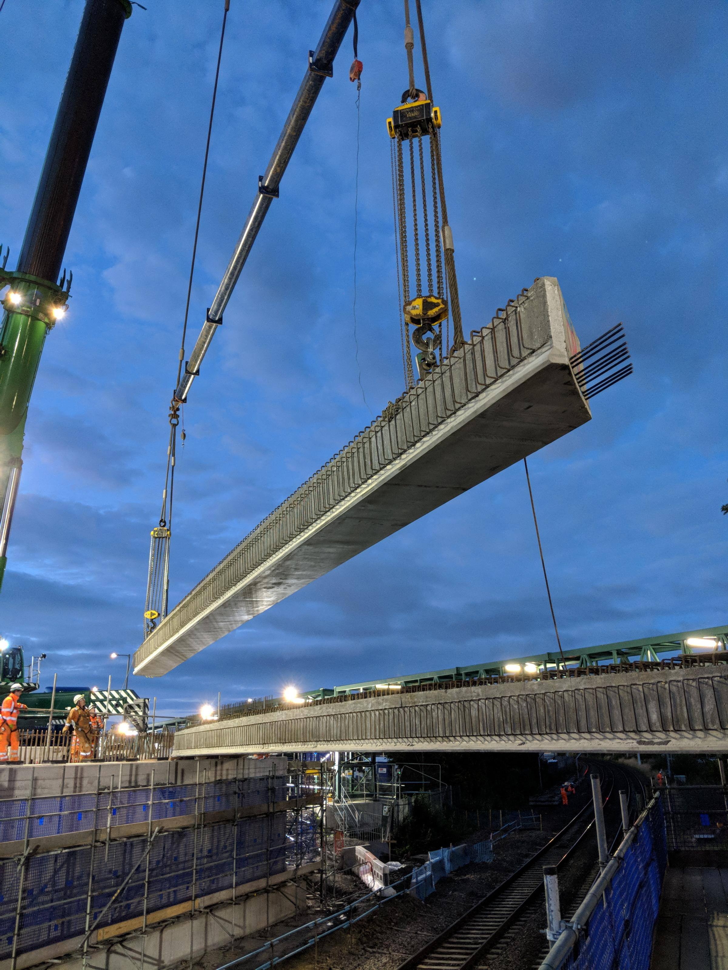 One of the beams being lifted in place by a 750t crane - courtesy of Network Rail