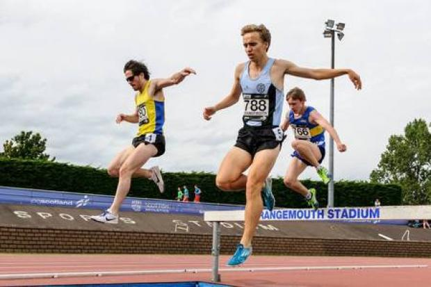 FINISHING LINE: Ali Hay celebrates as he wins the Scottish 5000m title. Pictured by Bobby Gavin