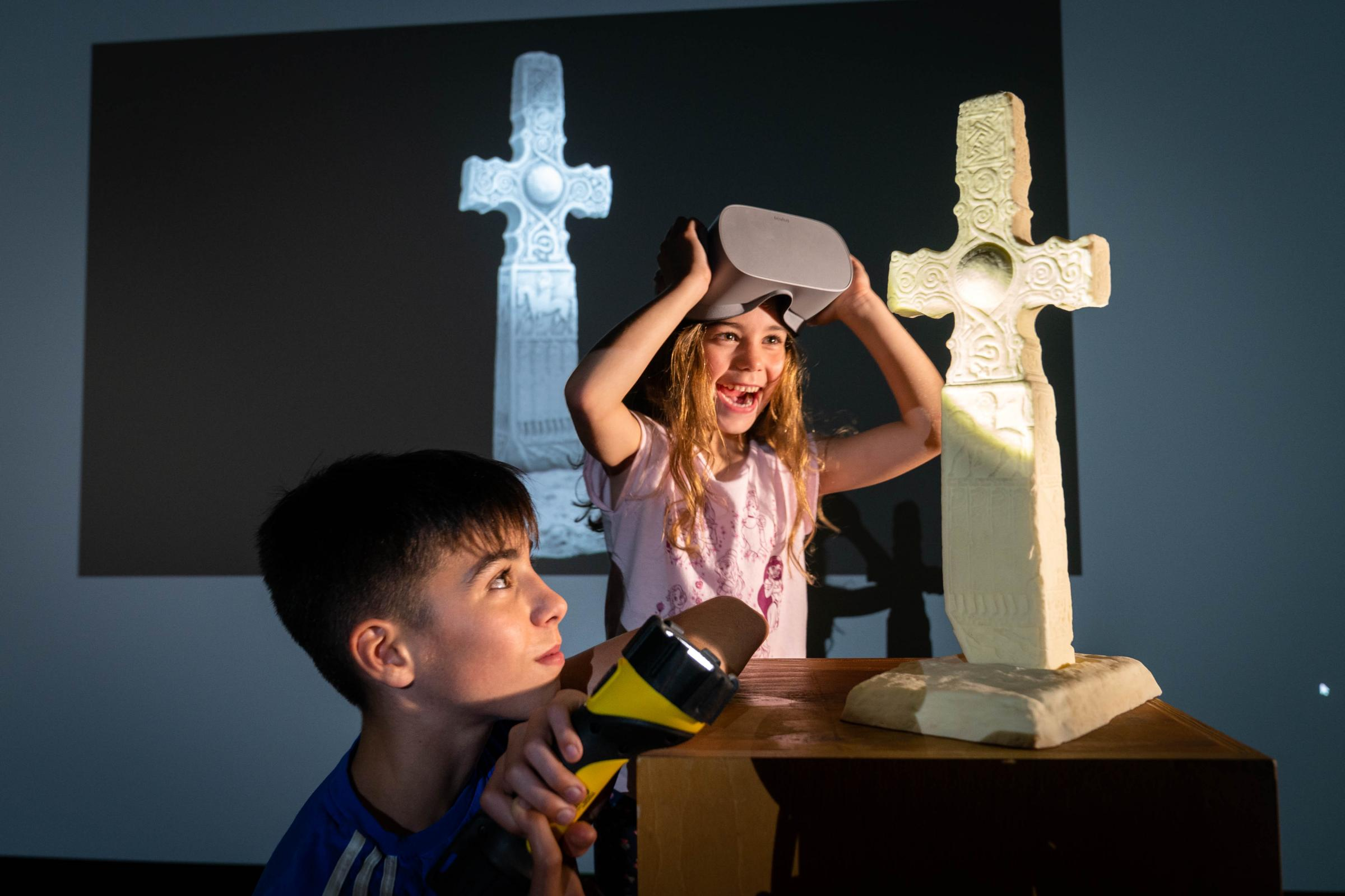 Ben Mitchell (10) and Ellie Mitchell (6) inspecting a 3D printed model of the Duppland Cross.