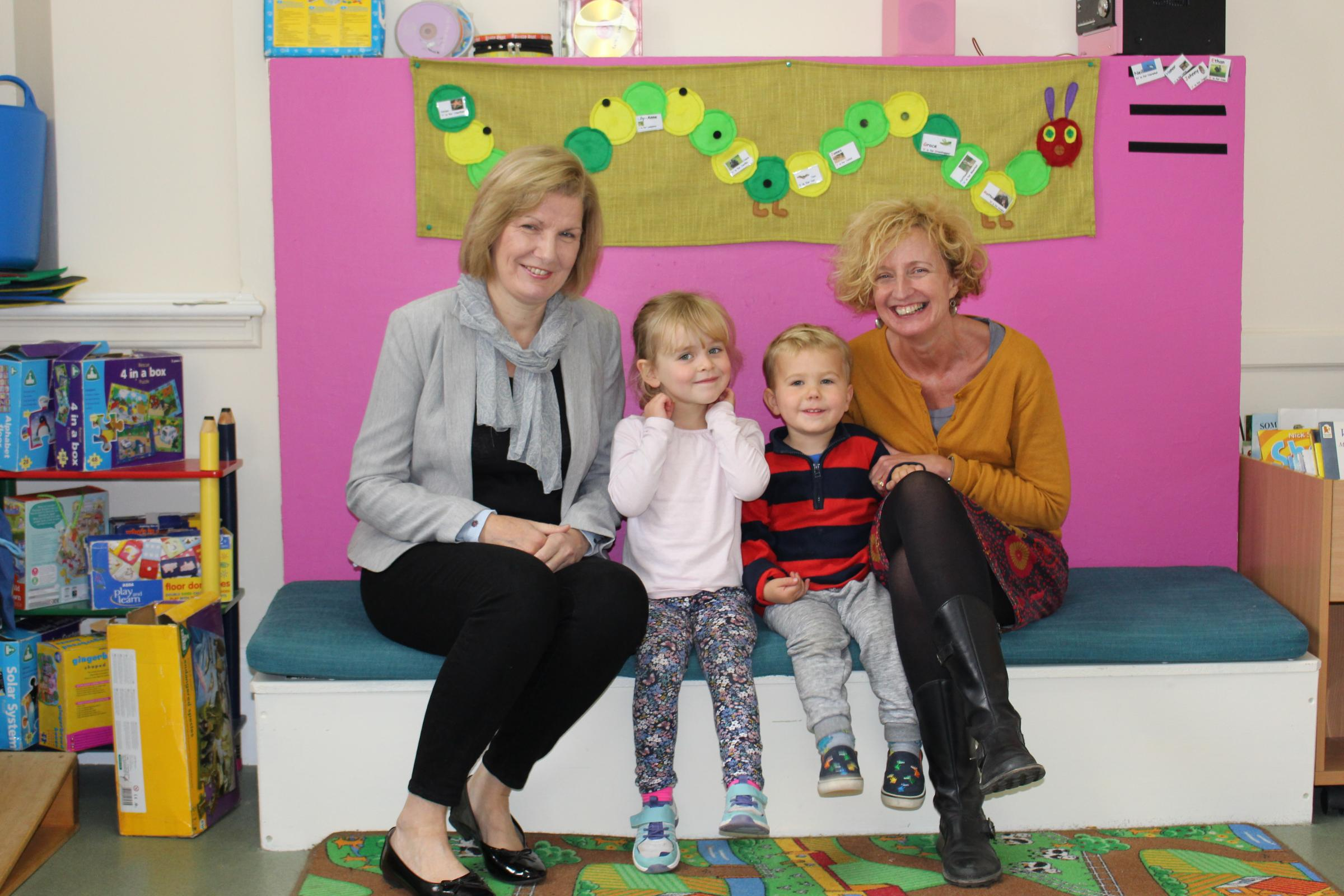 Councillor Susan McGill, left, with Red Kit Nursery manager Tracey Stewart, and two children