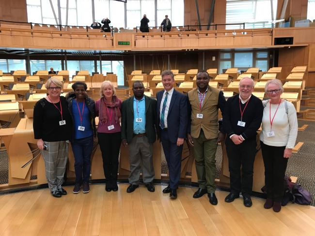 Members of the Dunblane Likhubula Partnership in the debating chamber at Scottish Parliament