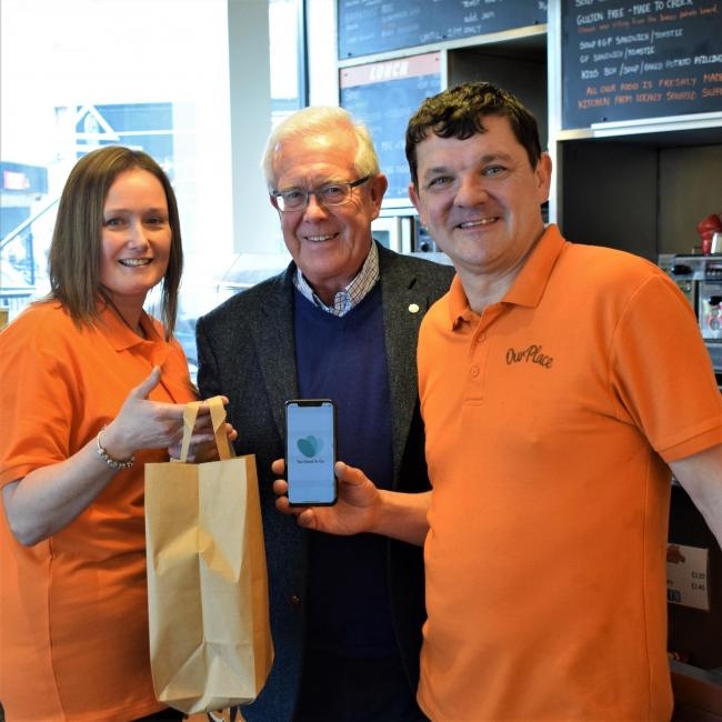 Café owners Helen and Alan Rodgers present MSP Bruce Crawford (centre) with a Too Good To Go magic bag