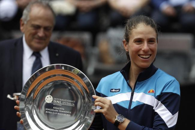 Johanna Konta holds up her runners-up trophy in Rome