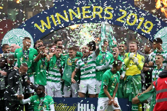 Celtic celebrate winning the William Hill Scottish Cup after victory over Hearts at Hampden